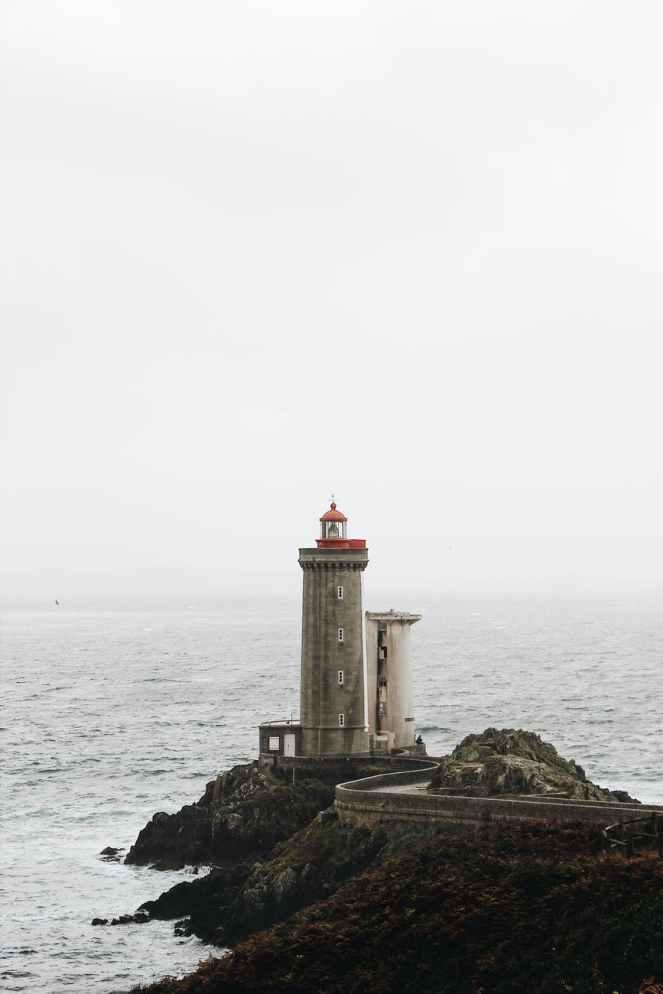 photo of lighthouse on seaside during daytime